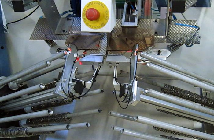 Machine de contrôle et de conditionnement d'anneaux